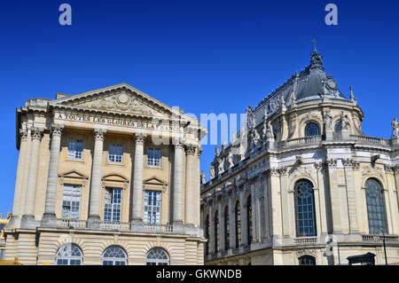 VERSAILLES, FRANCE - April 19, 2015: Ornamented buildings of the Royal Chapel in front of the Palace of Versailles, - Stock Photo