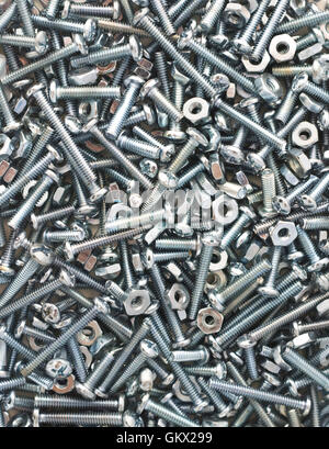 Nuts and bolts background. - Stock Photo