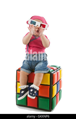 Portrait of cute female toddler with 3d glasses on white background - Stock Photo