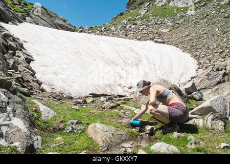 Summer hiking in Ariege area of Pyrenees,South of France. Hiking to Lake,Etang de Laurenti and Col de Laurenti.Snow - Stock Photo