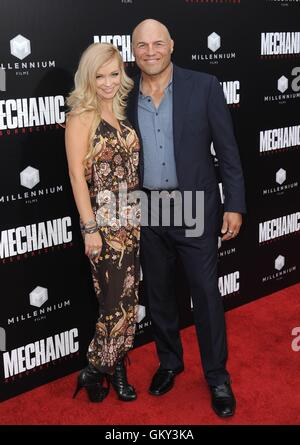 Hollywood, CA. 22nd Aug, 2016. Randy Couture, Mindy Robinson at arrivals for MECHANIC: RESURRECTION Premiere, Arclight - Stock Photo