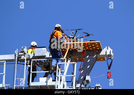 El Alto, Bolivia, 23rd August 2016. A technician secures a drone that is being used to carry a light synthetic cable - Stock Photo