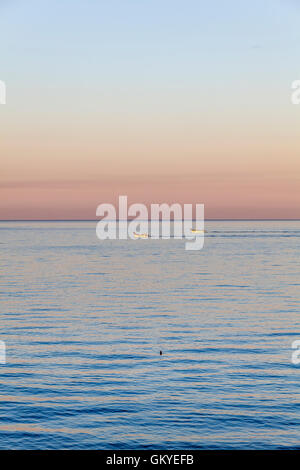 Anzio, Italy. 25th Aug, 2016. During the sunrise, fishing boats return to the port of Anzio.  Credit:  Yves Trenet/Alamy - Stock Photo