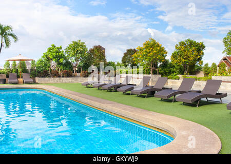 chair side swimming pool relax place. View from eye. - Stock Photo