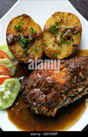 famous cordon bleu breaded fried chicken gravy and potatoes meal - Stock Photo