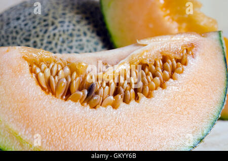 Cucumis melo or melon with half and seeds on wooden plate (Other names are cantelope, cantaloup, honeydew, Crenshaw, - Stock Photo