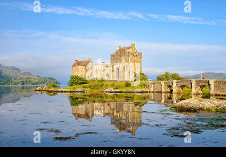 The castle at Eilean Donan reflected in the high tide on Loch Alsh - Stock Photo