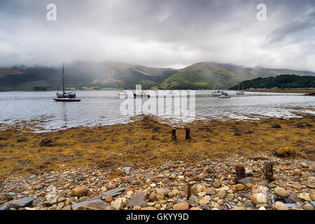 Boats at Loch Leven near Glencoe in the Scottish Highlands - Stock Photo
