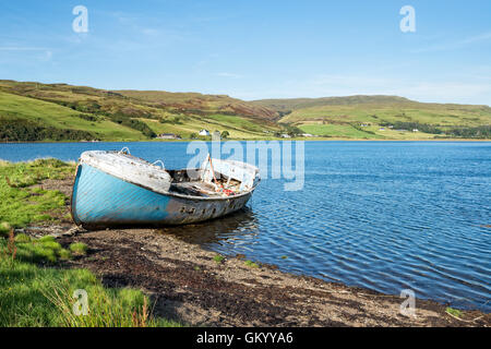 An old fishing boat on the shores of Loch Harport near Drynoch on the Isle of Skye in Scotland - Stock Photo