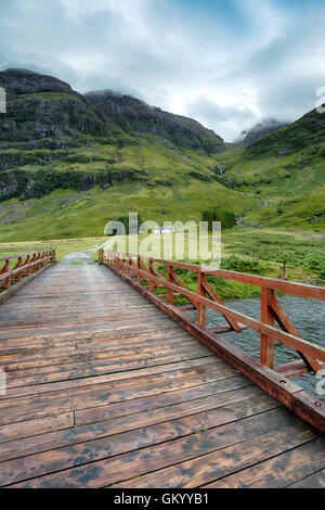 A mountain cottage at Glencoe in the highlands of Scotland - Stock Photo
