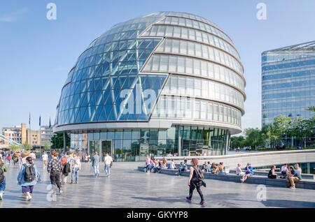 People outside City Hall, London, UK - Stock Photo