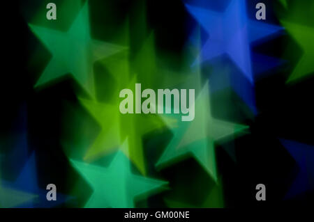 Blue and green stars bokeh abstract motion blur. Colorful background. - Stock Photo