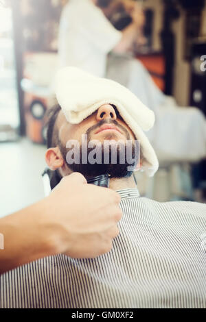 Traditional ritual of shaving the beard in a old style barber shop. - Stock Photo