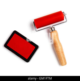red ink stamp and roller isolated on a white background - Stock Photo