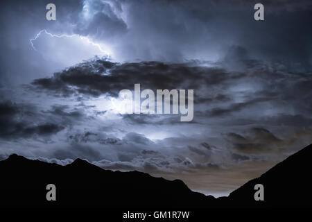 Lightning storm seen from St. Vincent, Aosta Valley, Italy, Alps, Europe, EU - Stock Photo