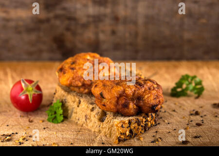 Fresh chicken meatball sandwich with tomato and herbs - Stock Photo