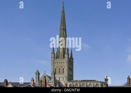 The spire of Norwich Cathedral against a blue sky.  Norwich, United Kingdom, Uk - Stock Photo