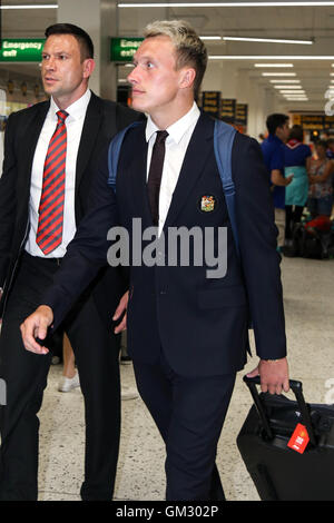 Phil Jones leaves Manchester airport for Manchester United's pre-season tour of China. - Stock Photo