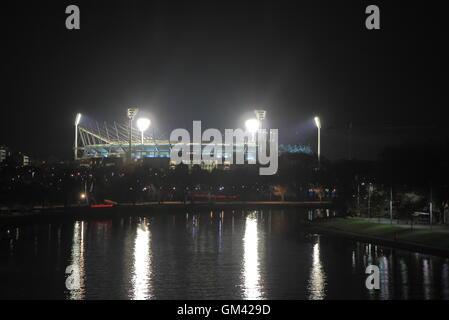 MCG by night over Yarra river Melbourne Australia - Stock Photo