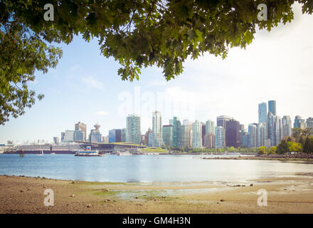 The beautiful skyline of downtown Vancouver, British Columbia, Canada, as seen from Stanley Park. - Stock Photo