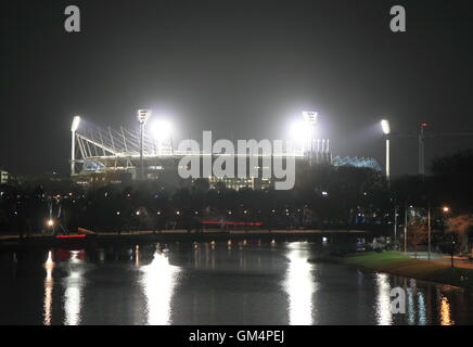 Melbourne Cricket Ground light reflects in Yarra river in Melbourne Australia. - Stock Photo