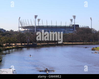 Athletes train rowing in Yarra river in Melbourne Australia. - Stock Photo