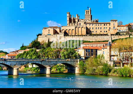The old Arch Bridge and cathedral Saint-Nazaire in the Beziers town - Stock Photo