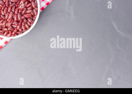 Red bean in bowl isolated. On black background,Top view and close up. - Stock Photo
