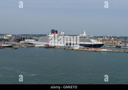 The cruise ship Queen Victoria, part of the Cunard Line, moored in Southampton harbour, UK; shot from the Arcadia. - Stock Photo
