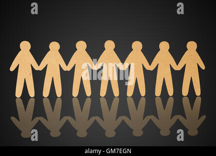 team of paper people on violet background - Stock Photo