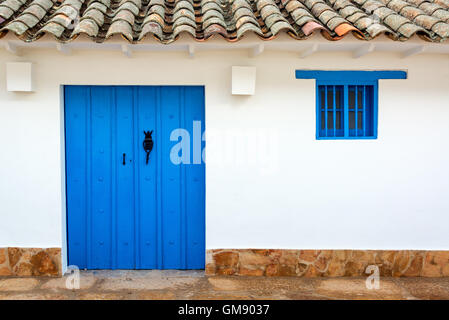 Blue door on a white colonial building in Villa de Leyva, Colombia - Stock Photo