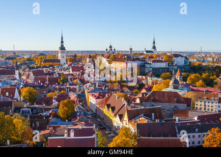 Classic panoramic view of full old Tallinn with towers, red roofs, churches and castle. Aerial view, autumn season - Stock Photo