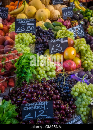 Various fresh fruits on display on a stall at Borough Market in London, UK - Stock Photo