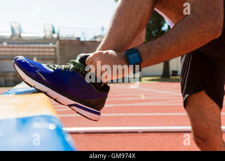 Sportsman, running shoe and smartwatch - Stock Photo