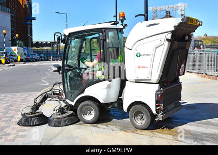 London Borough of Camden England UK local council street cleaning by compact mechanical road & pavement sweeper - Stock Photo