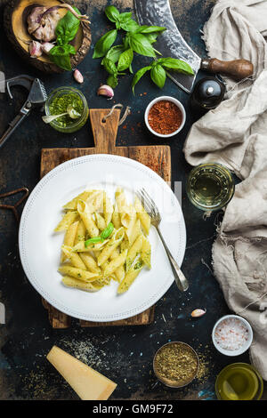 Penne with pesto sauce, parmesan cheese, fresh basil and spices - Stock Photo
