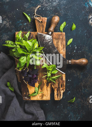 Fresh green and purple basil leaves with herb chopper knife - Stock Photo