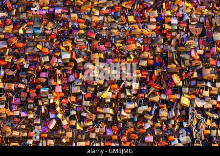 Germany, North Rhine-Westphalia, Cologne, Love padlocks on Hohenzollern Bridge - Stock Photo