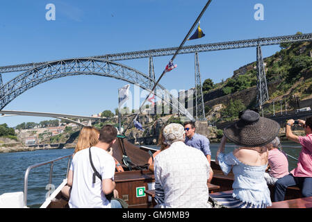 Tourists on a 6 bridges river cruise, Porto, Portugal. - Stock Photo