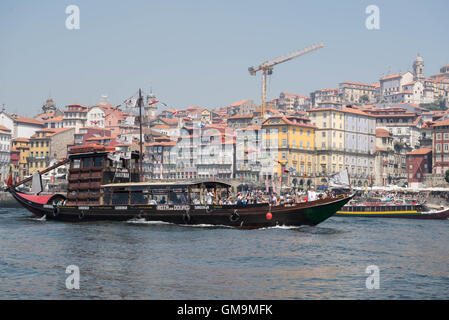 Tourists on a boat cruise on the river Douro, Porto, Portugal - Stock Photo