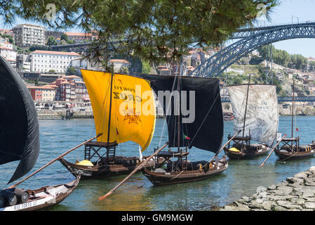 Barcos rabelos, traditional wooden boats, on the river Douro, Vila Nova de Gaia - Stock Photo