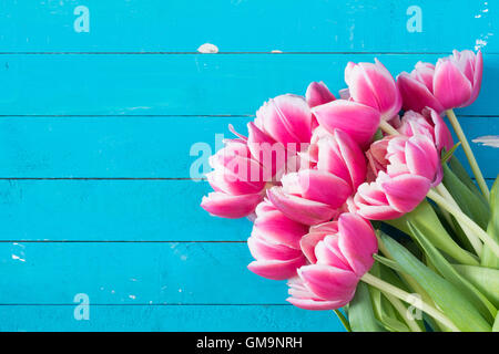Pink peony tulips on vintage blue background with copy space. Post card, gift card template. Wedding, birthday, - Stock Photo