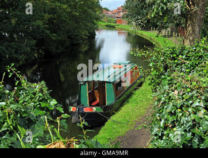 Narrowboat barge, boat moored on the Bridgewater Canal, Grappenhall village, Warrington, Cheshire, WA4 2PL, in summer - Stock Photo
