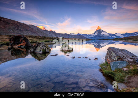 Matterhorn reflected in Lake Stellisee at dawn Zermatt Canton of Valais Pennine Alps Switzerland Europe - Stock Photo