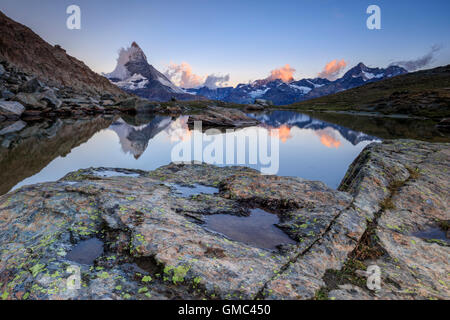 Matterhorn reflected in Lake Stellisee at dawn Zermatt Pennine Alps Canton of Valais Switzerland Europe - Stock Photo