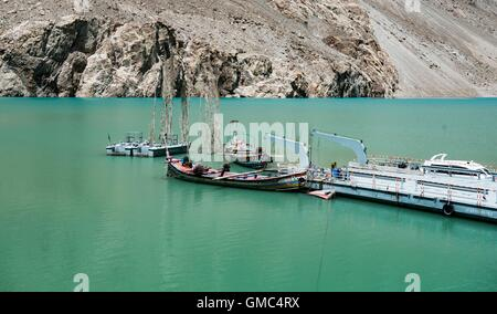 Abandoned ferry boats and pontoons on Attabad lake in the Gojal valley, Hunza, Gilgit-Baltistan, Pakistan - Stock Photo