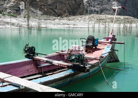 Abandoned ferry boat on Attabad lake in the Gojal valley, Hunza, Gilgit-Baltistan, Pakistan - Stock Photo