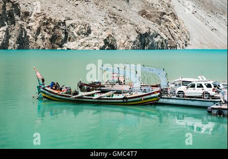 Abandoned boats and pontoon in Attabad Lake, Gojal, also known as Gojal Lake - Stock Photo