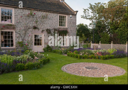 Circular paving design and flowers in beautiful, traditional, designed, landscaped, private garden - North Yorkshire, - Stock Photo