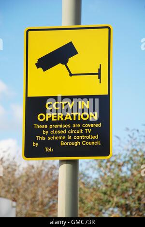 A yellow warning cctv security cameras sign stating that ...